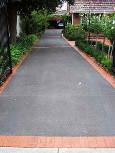 I like this asphalt driveway boardered with pavers idea could be quite economical
