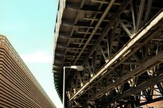 #architecture #bridge #light #lines #metal #perspective #point of view #road #sky #under the bridge