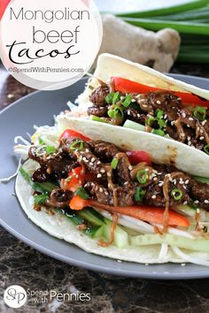 Like PF Chang's Mongolian Beef? You'll love this Mongolian Beef Taco recipe!  Ginger & soy flavored beef, loaded up with fresh veggies & an amazing sauce!