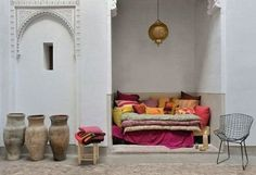 Cute moroccan inspired day bed nook. Gorgeous brass lantern and bold colours.