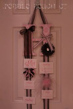 Cute gift to make for a baby girl to hang on the hospital door. Then they can bring it home to use as a bow holder and save the cards in her scrap book :)