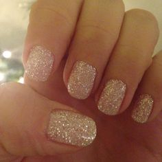 """""""paint your nail with a glue and then dip it in a jar of glitter (so it's called """"dip glitter"""") and then seal it with gel polish on top. The color was labeled """"USA #29."""""""""""