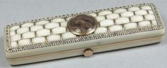 A 19th century ivory and gold toothpick box: of rectangular outline, the hinged lid of plaited design with hair plait inset panel, and mirror plate to the interior, 7.75cm. long.