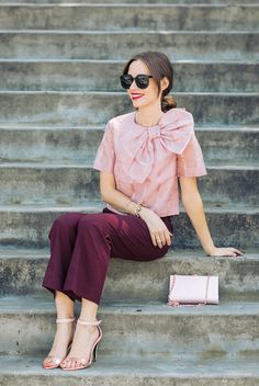 fall / winter - fall outfits - street style - street chic style - casual outfits - party outfits - formal outfits - pink bow crop top + burgundy ankle pants + metallic ankle strap heeled sandals + pink clutch + black sunglasses
