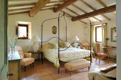 Col delle Noci Italian Villa rustic bedroom on the private estate of Castello di Reschio in the Umbrian countryside.