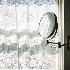 Beauty is eternity gazing at itself in the mirror.  This #stockphoto is available via Stocksy United Search: #raymondforbesllc  #mirror #lace #curtains #bathroom #decor #confidence #sun #beauty #selfesteem #woman #strong