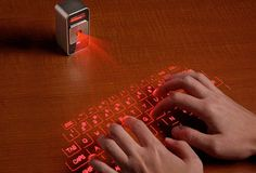 Incredible. Virtual laser keyboard. It uses a laser beam to generate a full-size perfectly OPERATING laser keyboard ... connects to MAC's, Smart Phones, any kind of PC and Most of the handheld devices