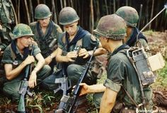 A rifle squad of the 1st Battalion, 2nd Infantry, 1st Infantry Division stop to examine a PRT-4 radio transmitter and PRR-9 receiver. All wear the black scarf, unique to the First of the Second.    Photo taken: August 1967