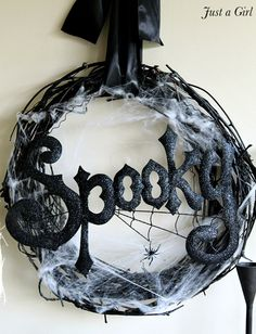 "http://www.pinterest.com/twmw/wreaths/  Black painted grapevine wreath with ""spooky"" and cobwebs. Cute for halloween"
