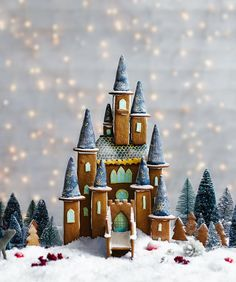 Make your Christmas extra special with this magical gingerbread fairytale castle. This spellbinding gingerbread creation features tasty turrets, golden windows, and a sprinkling of snow. Impress your guests with this stunning edible treat! Gingerbread Castle, Gingerbread House Designs, Christmas Gingerbread House, Christmas Sweets, Noel Christmas, Christmas Baking, All Things Christmas, Winter Christmas, Christmas Cookies