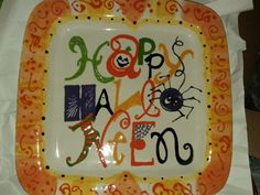 My Halloween platter painted after example at As You Wish Pottery