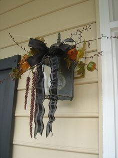 Halloween Front porch lamp with stuff from the garden.