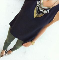 Black top and kaki jeans with kick-ass accessories
