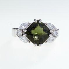 Elegantní stříbrný prsten s broušeným jihočeským vltavínem a kubickým zirkoniem v briliantovém výbrusu. Materiál: Stříbro 925/1000, rhodiovaný povrch zabraňující oxidaci a černání Hmotnost prstenu: 6,92 g Velikost vltavínu: 10 x 10 mm Prsten velikost: 60 Diamond Earrings, Stud Earrings, Engagement Rings, Jewelry, Enagement Rings, Wedding Rings, Jewlery, Jewerly, Stud Earring