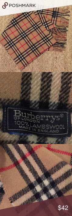 Burberry of London wool scarf Burberry of London 100% lambs wool scarf .   I've had this for a long time has some moth holes which I have showed in pics.  Lots of life left in this scarf.  Priced accordingly ... Burberry of london Accessories Scarves & Wraps