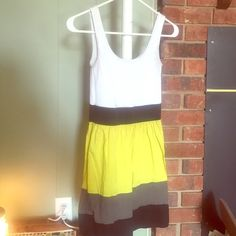 Say what bright yellow dress This is size XS but the top portion along with the black waste band stretch. Could easily fit a Small. Very cute and great for spring pictures. Say what Dresses