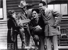 Charlie Chaplin with actress Mary Pickford, actor Douglas Fairbanks, and film director D.W. Griffith on the day they formed United Artists in 1919