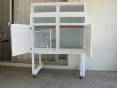 Lavonnes San Diego Mini Coop - BackYard Chickens Community - chicken coop that started out as a bathroom vanity.  Very clever!  With instructions.