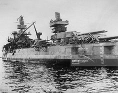 One of the ships which survived the atomic bomb explosion at Bikini Atoll - the battleship USS Arkansas. The bomb was dropped from 'Dave's Dream', on the target array anchored in the lagoon. Atomic Bomb Explosion, Battle Boats, Heavy Cruiser, Capital Ship, Us Navy Ships, Naval History, War Photography, Big Guns, Marshall Islands
