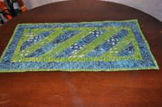 Blue and Green Table Runner out of Earth to Sky from Modern Yardage Fabric.  This table runner has a combination of blue and green 2 1/2 inch squares that are  sewn in diag... #quilting #quilt #richardquilts