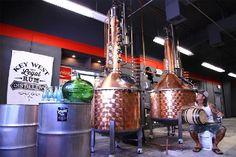 The stills , the barrel and distiller. key west rum distillery