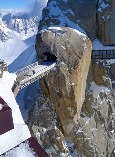 Mt. Aiguille du Midi is apart of the Mont Blanc massif in the Alps, France. There is a long cable cart that takes you all the way to a panoramic viewing platform, a cafe, and an amazing bridge