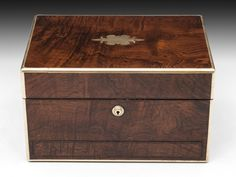 Antique Wooden Jewellery Box The interior is lined with blue leather paper and velvet, with a removable tray which features two compartments for rings, earrings and cuff links. Removing this tray reveals further storage space underneath for those precious items. Housed in the lid is a ruched velvet backed mirror which can be removed allowing access to a leather letter compartment.