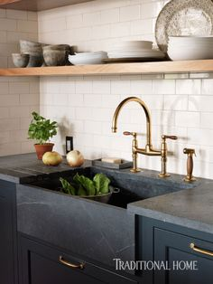 An unlacquered brass faucet from Waterworks and a soapstone sink and countertops are period-appropriate for the early 1900s apartment. - Photo: Jonny Valiant / Design: Blair Harris & Randy O'Kane