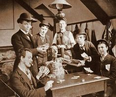 Medical students pose with a cadaver around 1890