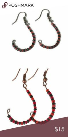 Fish hook earrings Handmade by me.  Resembling a fishhook these beaded earrings are dressed up a bit more than a regular fishhook.  Made with: Copper Tone Ear Wire Hook With Spring and Ball  2mm Black and Red seed beads Lots of love. Jewelry Earrings