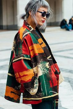messy silver hair and colorful lips and jacket - Street style via Man Repeller