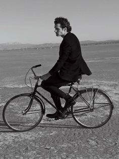 Henry Cavill; three-piece suit and on a bicycle; you gotta love it!