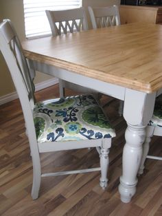 Recovering dining chairs. Painted grey table with stained top.