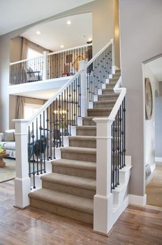 Open loft overlooking the living room. Love it. Would not have carpeted stairs though. Keep hardwood with MAYBE a runner