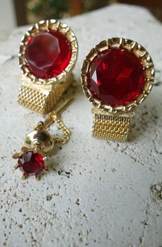 A fabulous pair of mens cufflinks by Swank. The round red glass stones are huge, reminiscent of the tail-lights on a vintage car! $35