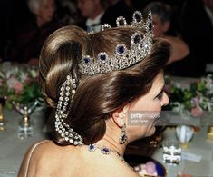 Queen Silvia Of Sweden Attends The Nobel Prize Banquet At The City Hall In Stockholm.Silvia The Swedish royal ladies do like to get creative with their tiara hair. They often take intricate hairstyles and add more jewels to them, such as brooches or strands of diamonds woven through