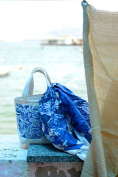 Blue floral tote, the final product after starting life as a lino cut.   Artist: Karen Mead Photo credit: Belinda Bath  #linocut #print #floral #blue #tote #canvas #embroidered #printmaker #louellaodie #artandadventure