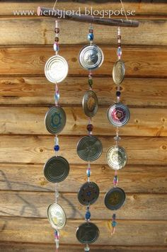 Wind chime from upcycled tin cans or used canning jar lids that have been painted.