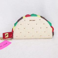 """Betsey Johnson Taco Wristlet This Betsey Johnson taco wristlet is the cutest and perfect for summer! ✨Made of woven synthetic material and faux leather. ✨Heart studs on shell. ✨Dimensions: 8.75""""L x 5""""H x 1.5""""W ✨About $82 w/ tax in stores. ✨Excellent condition! Betsey Johnson Bags Clutches & Wristlets"""