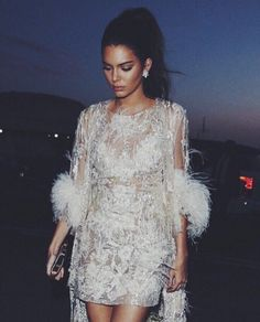 ::Kendall Jnner looks flawless in this white jeweled mini dress with fury sleeves::