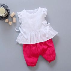 New Style 2017 Summer Baby Girls Clothes Sets Lace T Shirt Shorts 2 Pcs Infant Suits Comfortable Cotton Kids Casual SuitsGeorgia- Solid color two piece set. White sleeveless ruffle top with bow tie sides and layered lace ruffle bottom. Kids Dress Wear, Toddler Girl Dresses, Little Girl Dresses, Girls Wear, Baby Dress Design, Baby Girl Dress Patterns, Baby Frocks Designs, Kids Frocks Design, Baby Girl Fashion