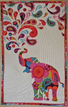 """""""Paisley Splash"""", or """"Don't Feed the Elephants L.S.D."""" I made this applique wall-hanging March, 2014."""