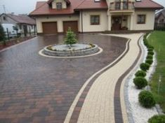A statement driveway as a continuation of the fabulous home style. this can be created with Holland pavers in (Red / Charcoal) using tan as the designated walkway. Front House Landscaping, Front Garden Landscape, Driveway Landscaping, Landscape Design, Stained Concrete Driveway, Stone Driveway, Front Driveway Ideas, Driveway Design, Pavement Design
