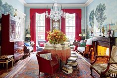 Room of the Day ~ A Waterford chandelier graces the front parlor, above a table draped with a circa-1850 paisley shawl; the armchair in the right foreground is George II, and the carpet was found on a trip to Cappadocia, Turkey. 10.6.2013