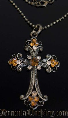 """Bronze colored steampunk cross with rhinestones."" Don't know that I would call that Steampunk, per se, but whatever."