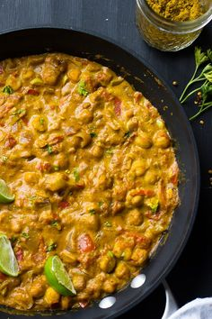 This Creamy Vegan Coconut Chickpea Curry is the BEST curry I've ever had! It's loaded with homemade grinded spices and incredily flavorful!