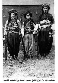 Kurdish fighters from nothern Iraq, followers of Sheikh Mahmud Barzani, King of Kurdistan (1922-1924).  In traditional attire and with old weapons.