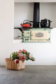This old Aga-type stove was discovered during the renovation of this Cape Winelands cottage. Wood Oven, Wood Fired Oven, Wood Stove Chimney, Spook Houses, South African Homes, Vintage Kitchen, Vintage Stove, Antique Stove, Cocinas Kitchen