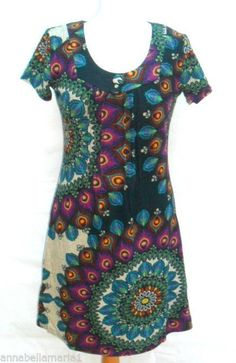 1e4c07c64976 Lovely tunic dress brought to you by Purplish London Funky print featuring  peacock colours Looks fab worn over leggings can be worn with another top
