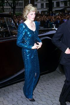 1985 – Princess Diana attends the UK film premiere of Lady Jane Grey, starring Helena Bonham Carter, in a twinkling blue sequinned dress.